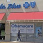 A person walks by a health care insurance office in Hialeah, Florida