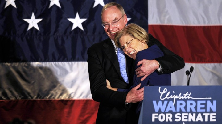 Elizabeth Warren and her husband, Bruce Mann, hug.