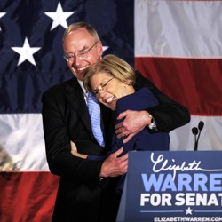 Elizabeth Warren and her husband, Bruce Mann, hug.