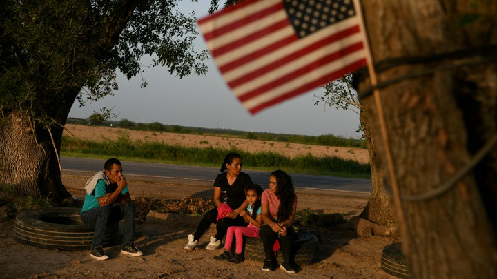 Central American asylum seekers wait to be transported to a processing facility after turning themselves in to the U.S. Border Patrol in Los Ebanos, Texas.