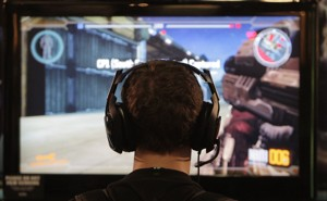 A gamer looking at a TV screen