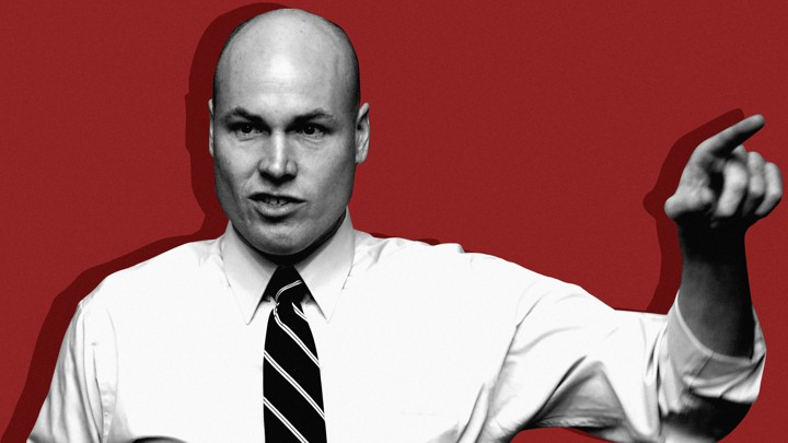 J. D. Scholten, the House candidate in Iowa, appears in a black-and-white photo, in front of a red background. He is pointing his left hand.
