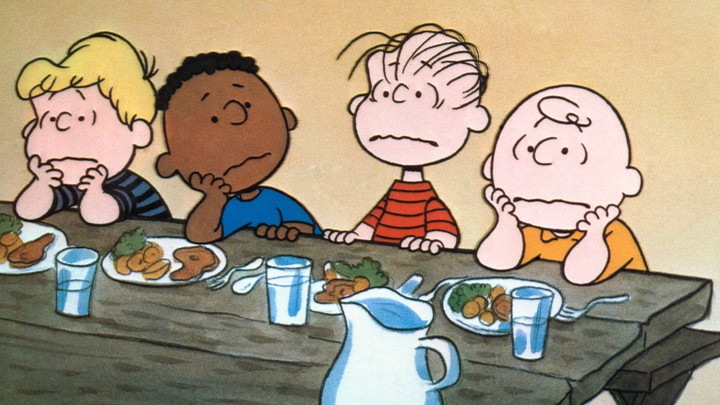 Schroeder, Franklin, Linus, and Charlie Brown look discouraged.