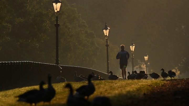A man runs through London's Hyde Park early in the morning.