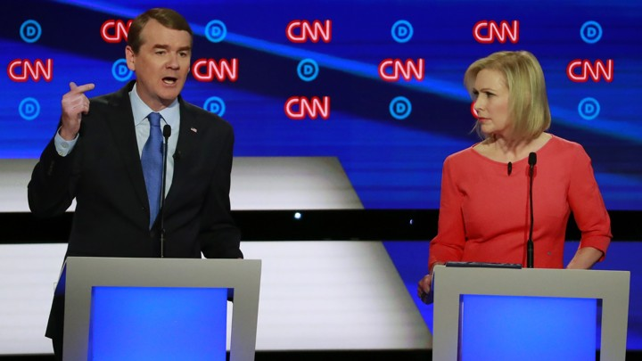 Candidates U.S. Senator Kirsten Gillibrand (right) listens as U.S. Senator Michael Bennet speaks on the second night of the second 2020 Democratic U.S. presidential debate in Detroit, Michigan.