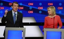 Candidates U.S. Senator Kirsten Gillibrand (right) listens as U.S. Senator Michael Bennet speaks on the second night of the second 2020 Democratic U.S. presidential debate in Detroit, Michigan.