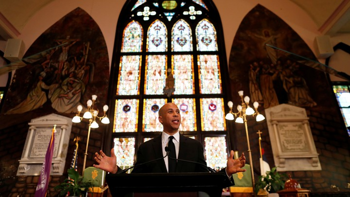 Cory Booker stands in front of a church tabernacle while speaking at the Mother Emanuel church in South Carolina.