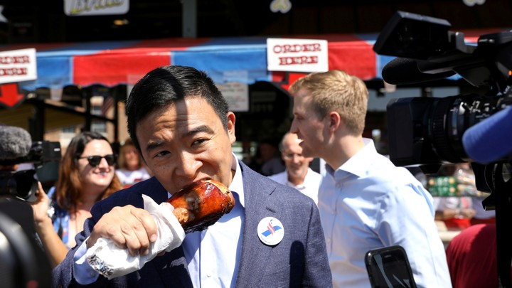 Andrew Yang enjoying a turkey leg at the Iowa State Fair