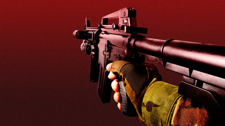A first-person view of an arm holding a gun in a video game