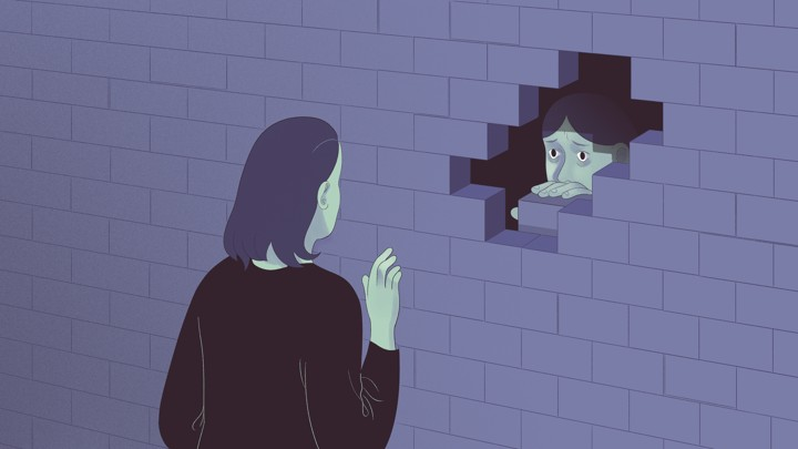 An illustration of a friend trying to reach another friend through a wall.
