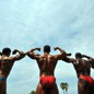 Men flex during a bodybuilding event in California.