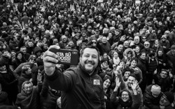 Matteo Salvini poses for a selfie with dozens of his supporters.