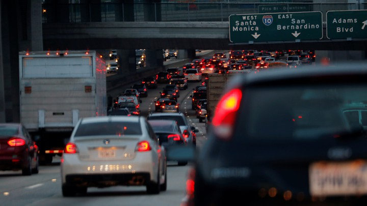 Cars and trucks drive in bumper-to-bumper traffic on a highway in Los Angeles.