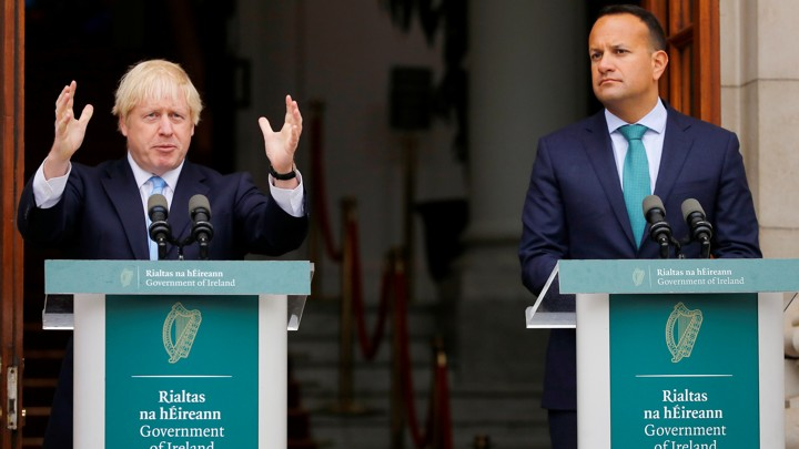 British Prime Minister Boris Johnson and his Irish counterpart, Leo Varadkar, stand behind lecterns to address the press.