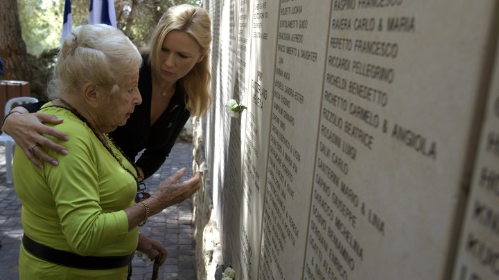 Holocaust survivor Marga Spiegel at Holocaust memorial site