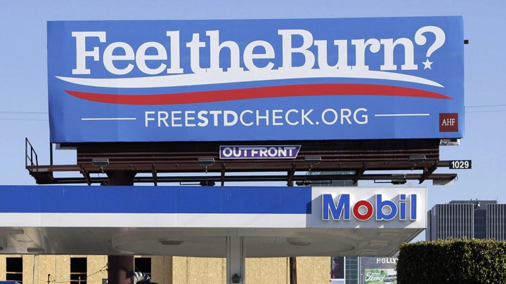 "A billboard shows a play on the presidential candidate Bernie Sanders's campaign slogan ""Feel the Bern."" It's actually promoting testing for sexually transmitted diseases."