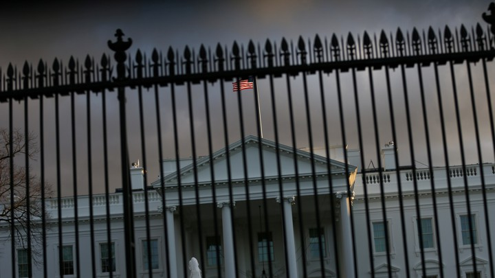 The White House is seen behind a gate.