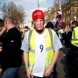 Pro-Brexit yellow vest protester in Trump mask
