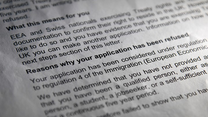 A close-up of a letter from the Home Office denying an EU national's request for permanent residency.
