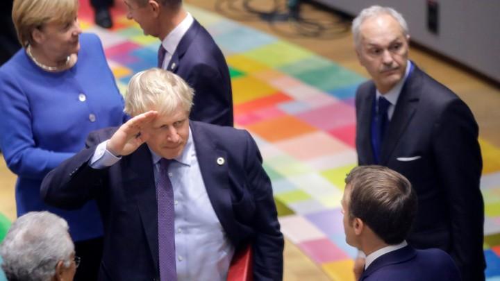 Boris Johnson salutes his fellow EU leaders.