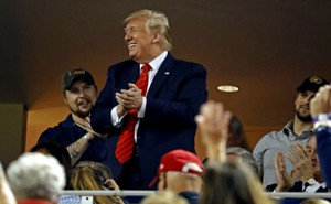 President Donald Trump waves to the crowd during Game 5 of the 2019 World Series.