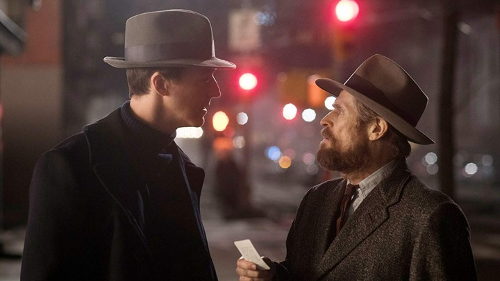 A still from the movie 'Motherless Brooklyn' of characters in conversation