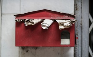 An old overflowing mailbox