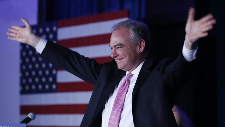 Tim Kaine raises his arms during an election party