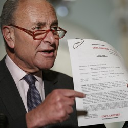 Senate Minority Leader Chuck Schumer of New York points to a copy of a White House–released rough transcript of a phone call between President Donald Trump and the president of Ukraine.