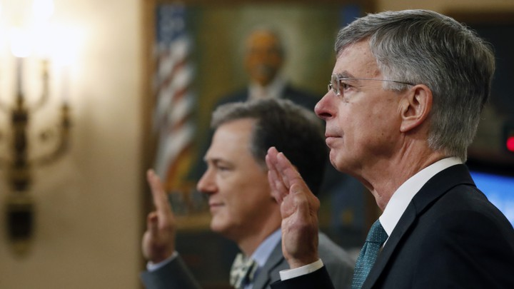 William Taylor (<i>right</i>) and George Kent (<i>left</i>) are sworn in to testify before the House Intelligence Committee on Capitol Hill.