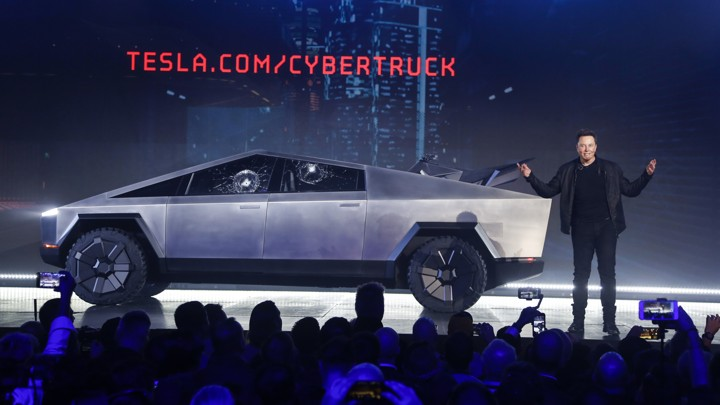 Tesla CEO Elon Musk introduces the CybertTruck at Tesla's design studio Thursday, March 14, 2019, in Hawthorne, Calif
