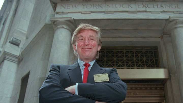 Donald Trump poses outside the New York Stock Exchange.