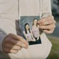 Bobbie Lynn Hodges holds a photo of herself with her best friend, the woman formerly identified only as Lavender Doe.