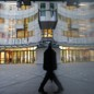 A man walks past the BBC's New Broadcasting House in London.