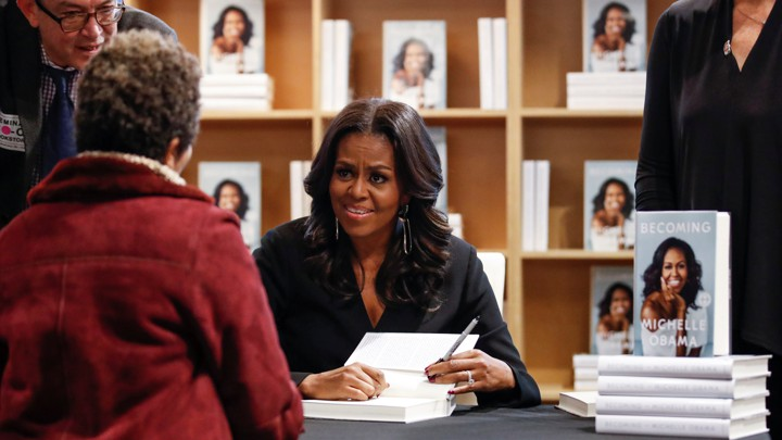 Michelle Obama signing books