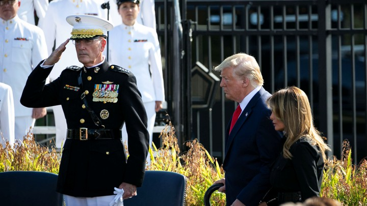 Joseph Dunford salutes as Donald Trump walks past.
