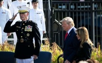 Joseph Dunford salutes as Donald Trump walks past.