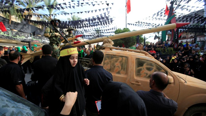 A Hezbollah parade, with a mock rocket launcher, in 2016