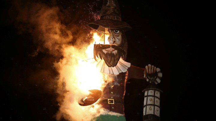 A photo of a burning effigy of Guy Fawkes.