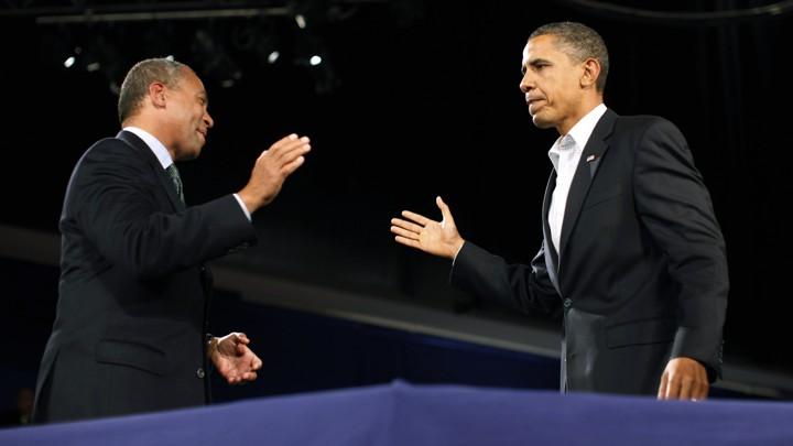 Deval Patrick and Barack Obama prepare to high-five.