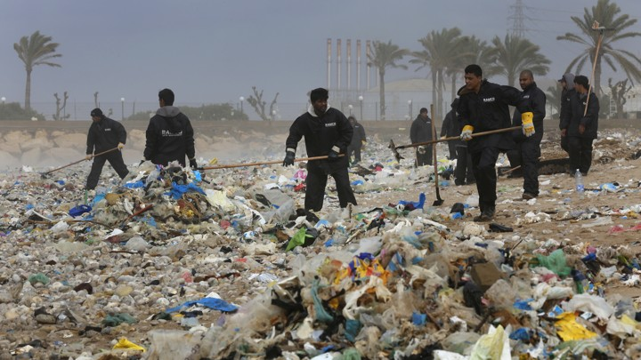 Enormous piles of trash are seen on a Lebanese beach.