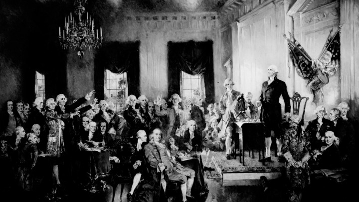 A painting of George Washington presiding over the signing of the Constitution at the Constitutional Convention in Philadelphia on September 17, 1787