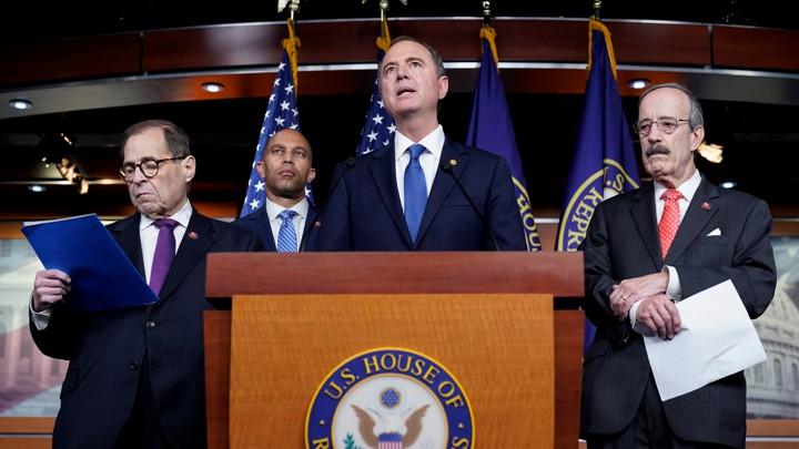 Adam Schiff, Jerrold Nadler, Hakeem Jeffries, and Eliot Engel speak in front of a podium during a media briefing.