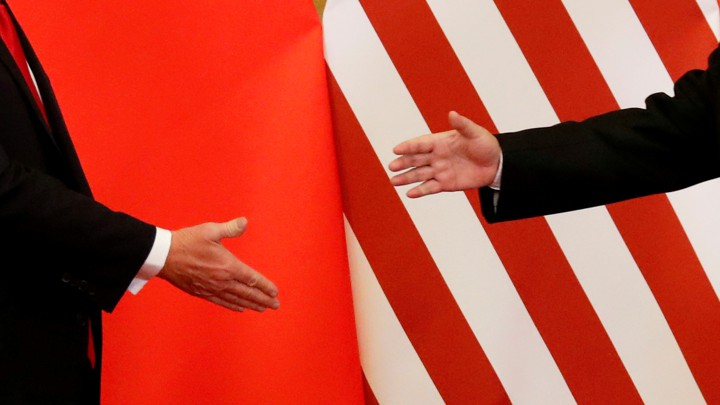 President Donald Trump and China's President Xi Jinping shake hands in Beijing.