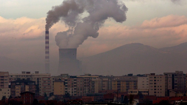 A coal-fired power plant in Kosovo release smoke into the sky.