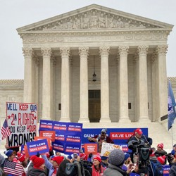 Supporters of gun-control laws rally in front of the Supreme Court.