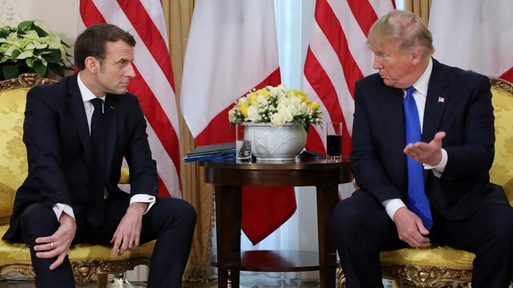 Emmanuel Macron talks with Donald Trump.