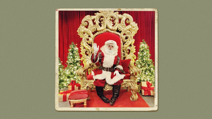 A photo of Noam Osband in his Santa costume.