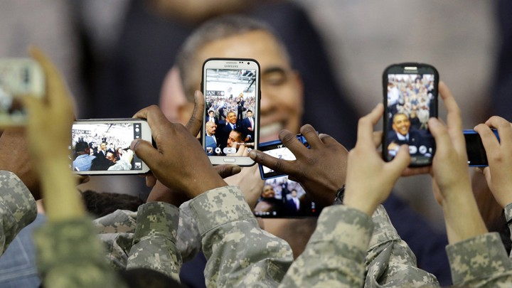 U.S. troops snapped photos of President Barack Obama after he delivered a speech in Seoul on April 26, 2014.