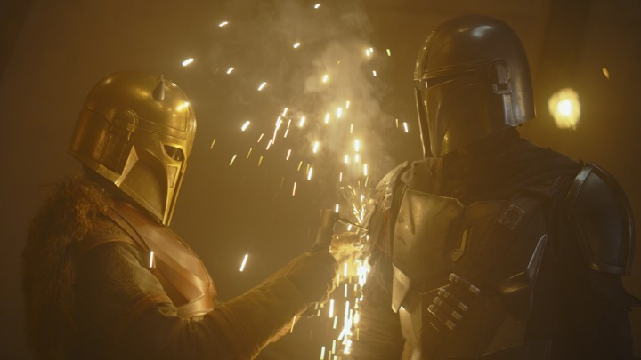 The Armorer (left) and the Mandalorian (right).
